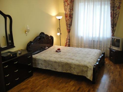 Кровать или кровати в номере Дом у моря