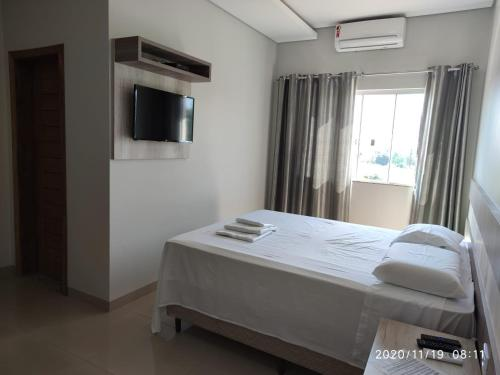 A bed or beds in a room at Master Hotel