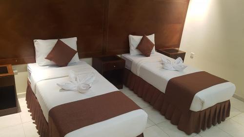 Cama ou camas em um quarto em Fal Al Taj Hotel