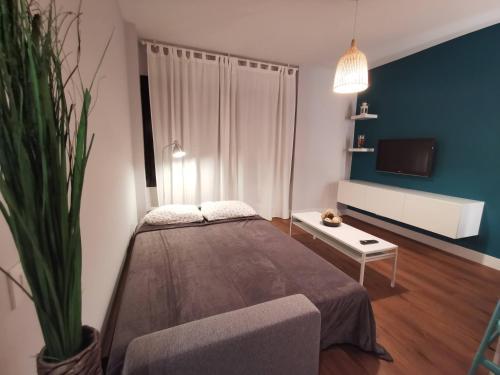 A bed or beds in a room at Exclusivo apartamento en Triana junto al centro