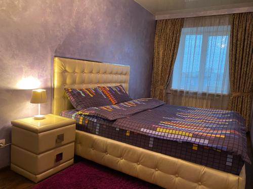 A bed or beds in a room at Kharkiv Center Apartment on Hoholya Str, Poetry square