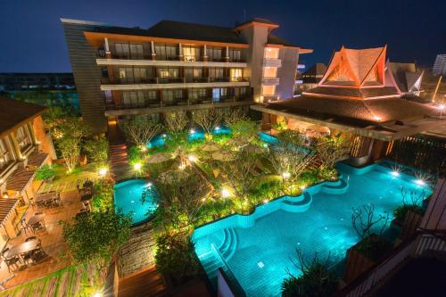 A view of the pool at Ayrest Hua Hin Hotel or nearby