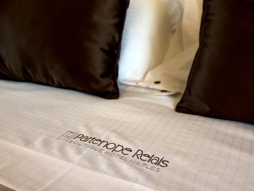 A bed or beds in a room at Partenope Relais
