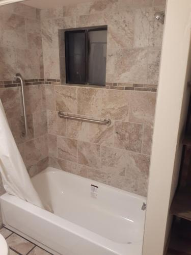 A bathroom at Stagecoach Suites