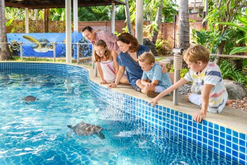 A family staying at JW Marriott Phuket Resort and Spa - SHA Plus