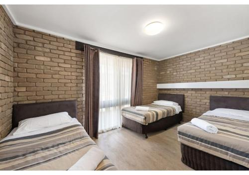 A bed or beds in a room at Discovery Parks - Warrnambool