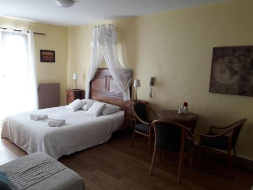 Ein Bett oder Betten in einem Zimmer der Unterkunft Villa Rosa Trois Epis