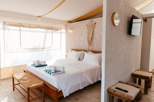 A bed or beds in a room at Sails on Kos Ecolux Tented Village