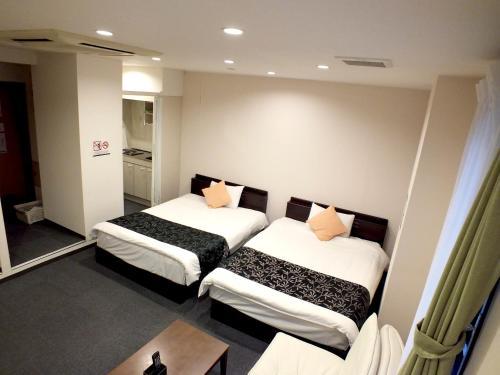 埃爾貝斯特酒店及公寓房間的床