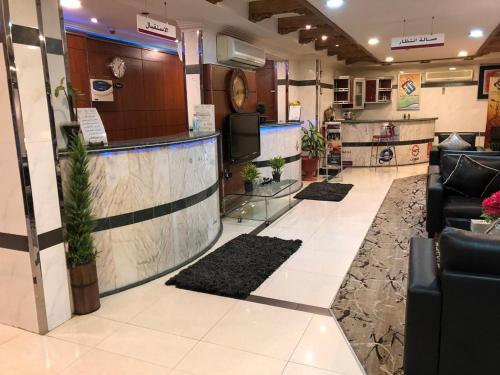 O saguão ou recepção de Najmat Manami AlQuds