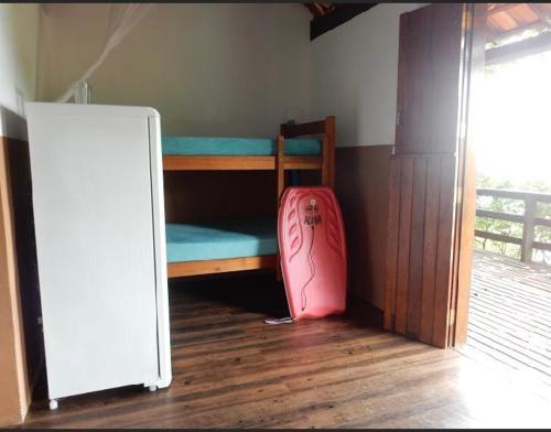 A bunk bed or bunk beds in a room at Pousada Mar de Sonhos