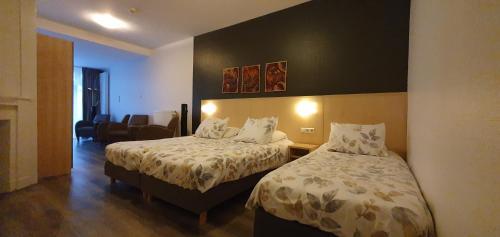 Un ou plusieurs lits dans un hébergement de l'établissement Hotel Bor Scheveningen