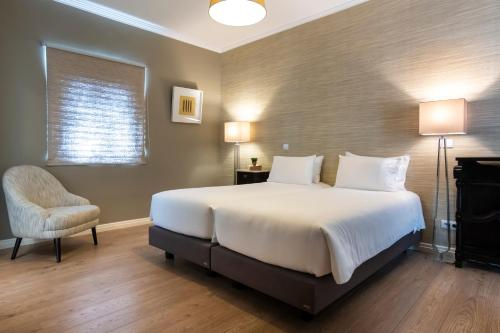 Uma cama ou camas num quarto em Quinta da Abelheira