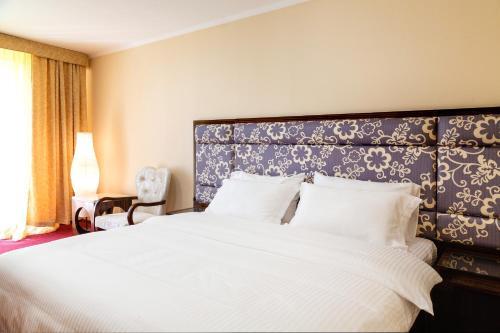 Кровать или кровати в номере МОРОЗОВО Курорт-Отель СПА