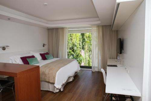 A bed or beds in a room at Ilum Experience Home