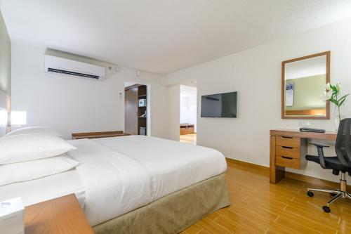 A bed or beds in a room at Dhafra Beach Hotel