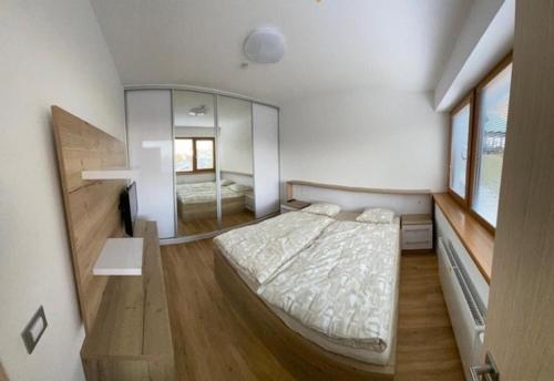 Postel nebo postele na pokoji v ubytování Hotel U Kabinky