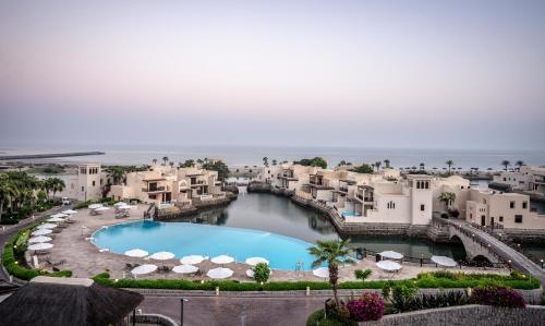 A view of the pool at The Cove Rotana Resort - Ras Al Khaimah or nearby