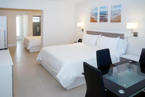A bed or beds in a room at Diane Oceanfront Suites