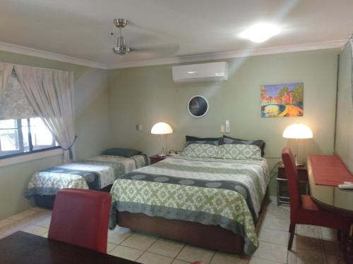 A bed or beds in a room at Homestay at Julie's