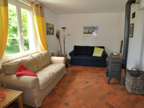 A seating area at Quaint Holiday Home with Swimming Pool in Montrichard France