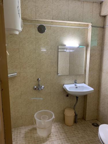 A bathroom at Hotel Jc Grand