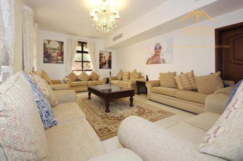 A seating area at New Arabian Garden Villa in Falcon City