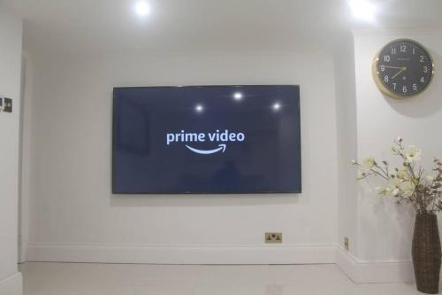 A television and/or entertainment center at 1 BED FLAT