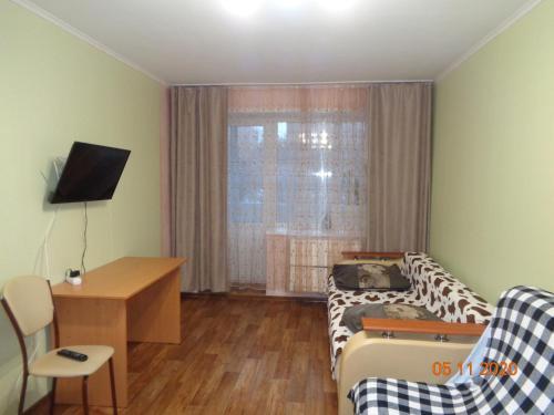 Гостиная зона в Uchebnaya 7 - 2 Bedroom