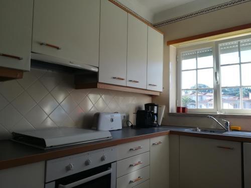 A kitchen or kitchenette at Apartment Beach Pool Golf Silver Coast H4U
