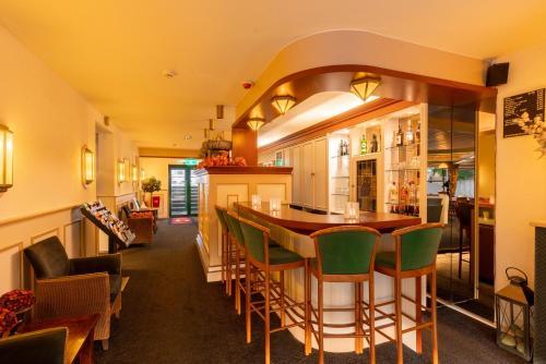 Restaurant ou autre lieu de restauration dans l'établissement Owl Hotel