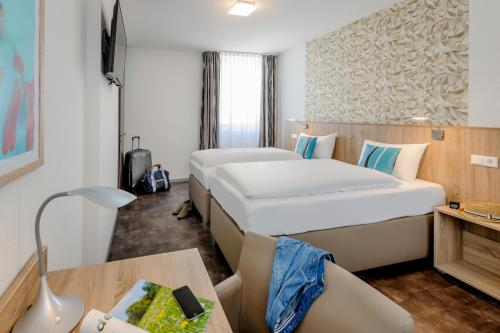 A bed or beds in a room at ibis Styles Arnsberg Sauerland
