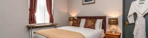 A bed or beds in a room at Cappadocia Guest House