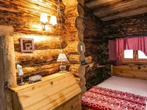 Кровать или кровати в номере Русская Усадьба