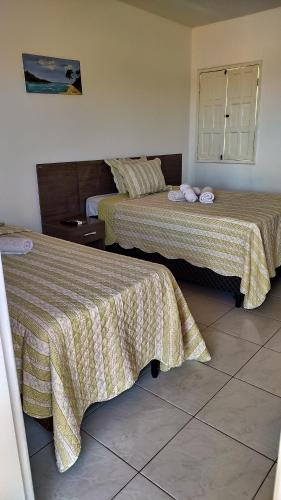 A bed or beds in a room at Pousada Marihá