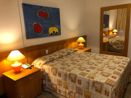 A bed or beds in a room at Tropical Barra Hotel
