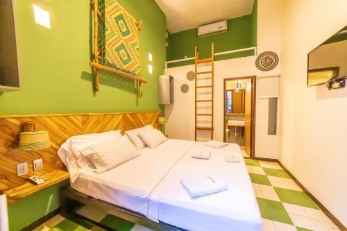 A bed or beds in a room at Masaya Santa Marta