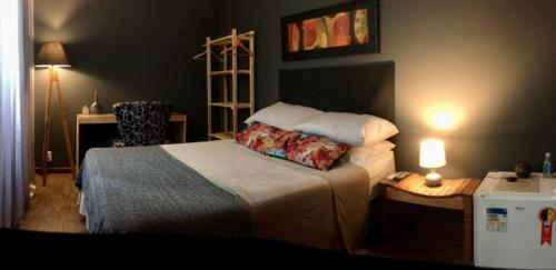 A bed or beds in a room at Terrassé São Francisco
