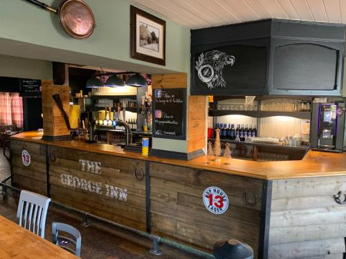 The lounge or bar area at The George Inn Middle Wallop