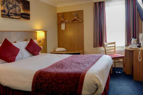 A bed or beds in a room at Best Western London Highbury