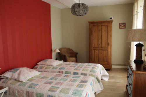 Un ou plusieurs lits dans un hébergement de l'établissement Chambres d'Hôtes Les Champs Français