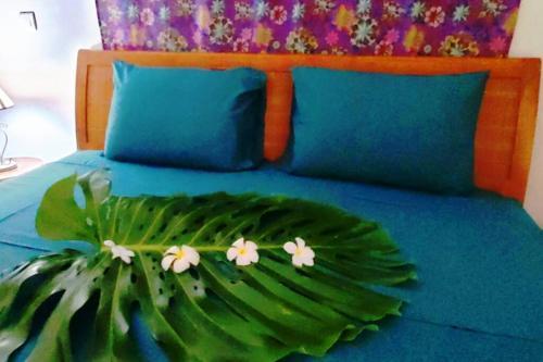 Cama ou camas em um quarto em Naia Lodge Tahiti