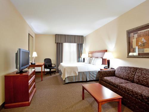 A television and/or entertainment center at Holiday Inn Hotel & Suites Beckley, an IHG Hotel