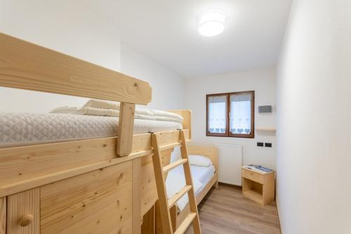 A bunk bed or bunk beds in a room at Dolomitissime Holiday Homes Alleghe