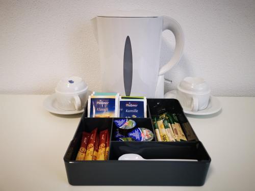 Coffee and tea-making facilities at Gästehaus Häuser