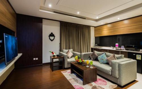 Uma área de estar em Myan Al Urubah Hotel