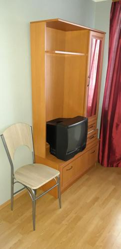 A television and/or entertainment center at Hansa Apartment