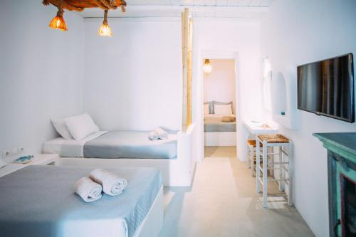 A bed or beds in a room at Mykonos Supreme Comfort Suites