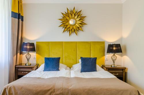 A bed or beds in a room at Prawdzic Resort & Conference