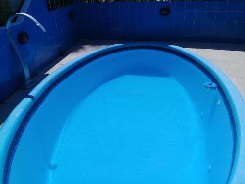 The swimming pool at or close to Casa de praia descanso em família